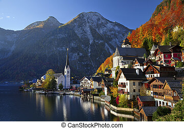 Image of famous alpine village Halstatt during colourful fall morning.