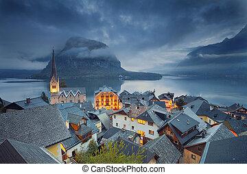 Image of famous alpine village Halstatt during twilight blue hour.