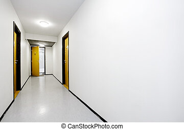 Hallway - A sterile empty hallway with a single door open