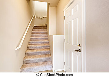 Hallway interior. View of carpet stairs.