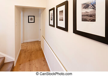 Hallway interior - Wooden floor and neutral walls in a...