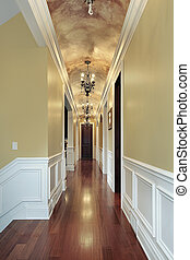 Hallway with chandeliers in luxury suburban home