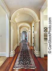 Hallway with curved arches - Hallway in luxury home with...