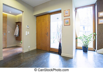 Hallway with rear doors - Big bright hallway with wooden...