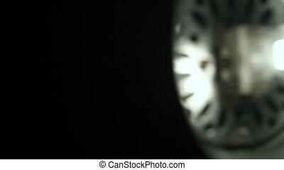 Halogen bulb studio lighting. Dolly shot. Close up