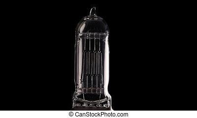 Halogen lamp. Real light bulb flickering. Tungsten filament...