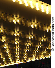 Looking up at an overhang with halogen marquee lights