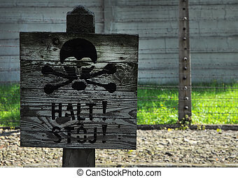 HALT, STOJ (english: STOP) sign with painted skull, wired...