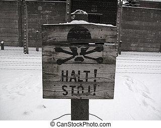 Halt! Stop! - Tablet STOP! infront of barbed wire under...