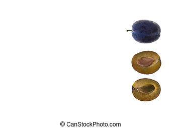 halved and whole damson plum isolated on white background ...