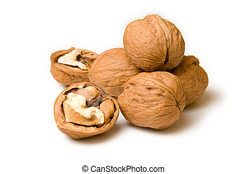 Halves and a pile of walnuts on a white background