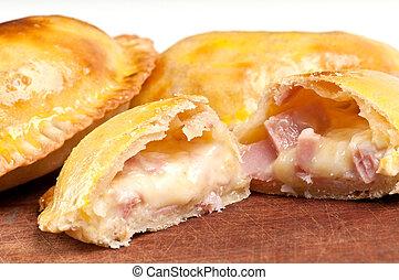 Ham and Cheese Empanada fill close up. The Empanada is a...