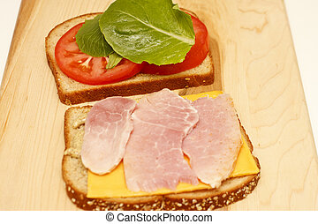 Ham and Cheese Sandwich Open on Cutting Board
