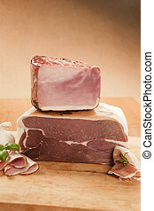 Ham and prosciutto piece.