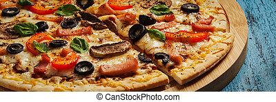 Ham pizza close up letterbox - Letterbox panorama of ham...
