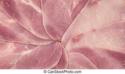Ham Platter Rotating - Overhead shot of ham slices turning...