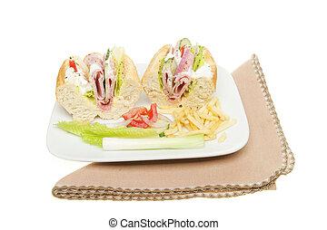 Ham salad baguette on plate with a serviette