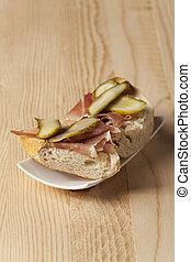 ham sandwich on a white plate