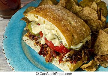 Ham sandwich on ciabatta bread with pickles