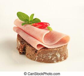 Ham sandwich  - Thin slices of ham on brown bread