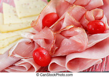 Ham - Sliced ham on plate in red tone