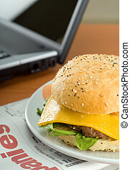 Hamburger and laptop - Office business lunch food cheese ...