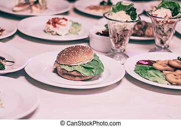 hamburger and other fast food on the table