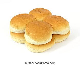 Hamburger buns - A group of hamburger buns on a white...