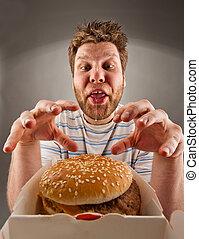 hamburger, homme, préparer, manger, heureux