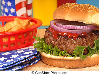 Hamburger in 4th of July setting - Freshly grilled hamburger...
