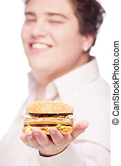 hamburger in hand of a young chubby man