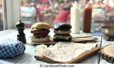Hamburger on a wooden board.