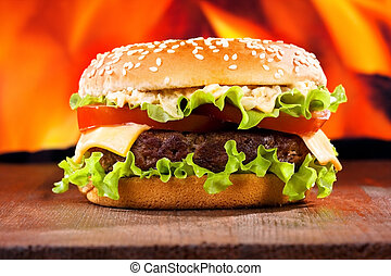 hamburger on fire background