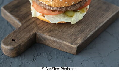 Hamburger on the wooden background - Top view bbq hamburger...