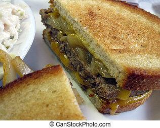 Hamburger Sandwich - Closeup of a grilled ground beef patty,...