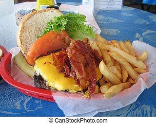 Hamburger - Shot of a hamburger with cheese, bacon, tomato,...