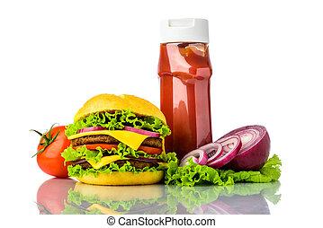 Hamburger, vegetables and ketchup