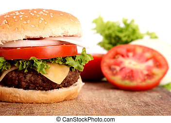 hamburger with bread,tomato,onion,lettuce,meat,cheese,ham...