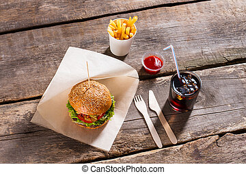 Hamburger with cola and fries.