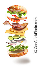 hamburger with flying ingredients on white background