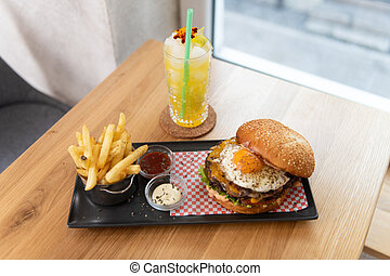 Hamburger With French Fries and Cocktail Fruit Mojito