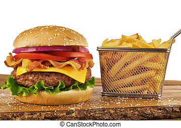 Hamburger with french fries in basket, ketchup and mustard bottle.