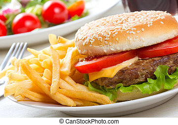 hamburger with fries and salad