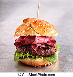 Hamburger with roast beef on a sesame bun