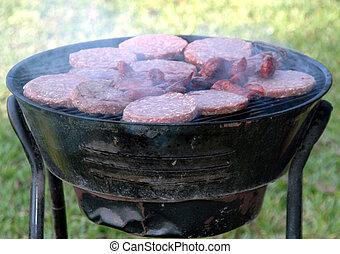 Hamburgers grilling.