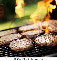 hamburgers grilling on charcoal grill