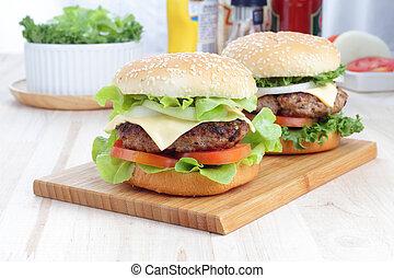 Hamburgers on a wooden board