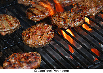 Hamburgers on barbeque - Hamburgers cooking on barbeque...