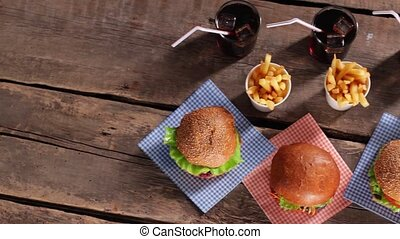 Hamburgers with fries and cola. Fast food menu on table....