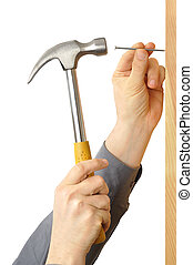 Hammer and Nail - Hands with hammer and nail isolated on...